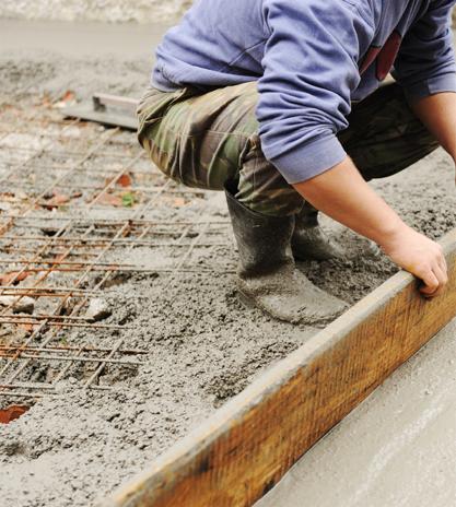 Builder leveling a concrete slab