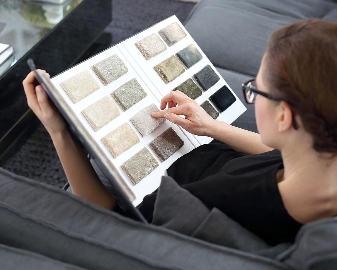woman choosing carpet samples