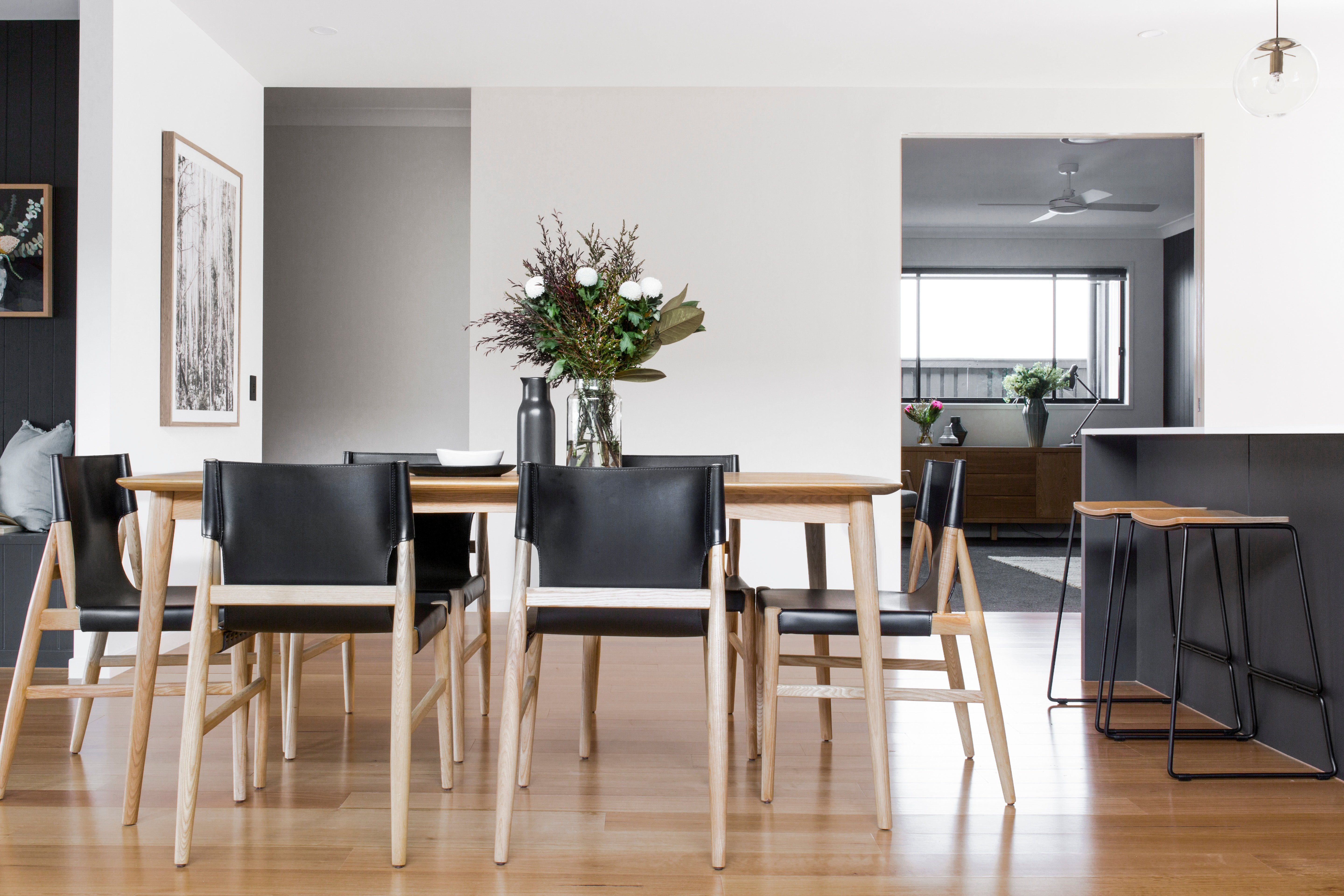 DC Living Home Builder Dining Room Black Leather and Timber furniture